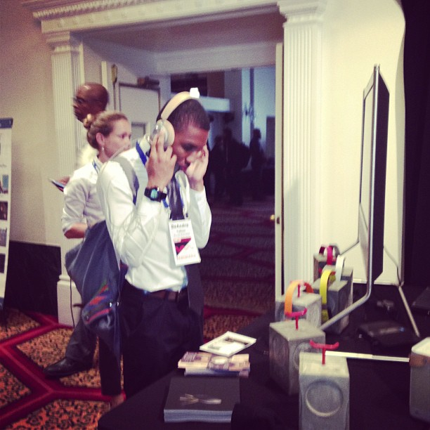 A New Music Seminar attendee samples a pair of B&O headphones.
